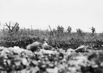 Men of the Wiltshire Regiment advancing to the attack through the wire, Thiepval, Somme, 7 August 1916.