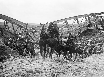 Horse team of the Royal Field Artillery pulling an 18 pounder field gun up the slope of a cutting through the bank of the Canal du Nord near Moeuvres, 27 September 1918.