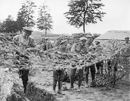 British troops making camouflage netting at Basseux on 16 June 1918.