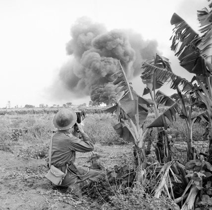 AFPU photographer Sergeant E.E. Miller in action with the 5th Indian Division during the drive on the Rangoon in Burma, December 1944.