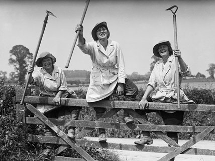 Three members of the Women's Land Army employed on an English farm during the First World War.