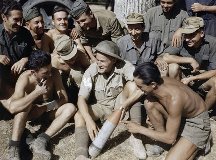 Sergeant P Hopkinson of the Royal Engineers, the first Allied soldier to be attached to an Italian Unit after the Armistice, with Italian artillerymen who are explaining shell markings to him, 22 September 1943.