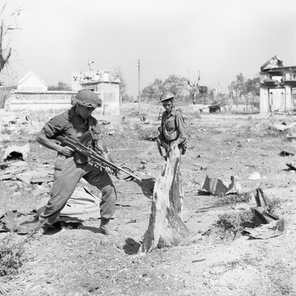 Troops of the West Yorkshire Regiment warily search Japanese dugouts in Meiktila, Burma, 28 February 1945.