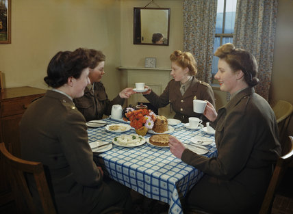 Members of the Auxiliary Terrotorial Service have tea during a domestic science course for service women at Avondale Park School, Notting Hill Gate, London, 1945.