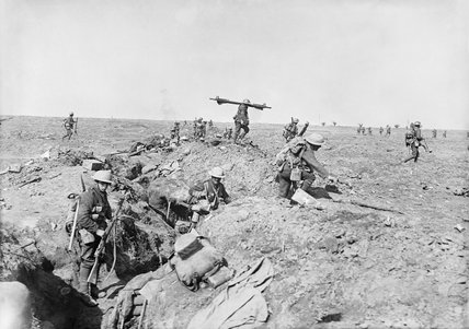 Supporting troops scramble out of their trenches to go forward near Ginchy,The Battle of Morval, Somme, 25 - 28 September 1916.