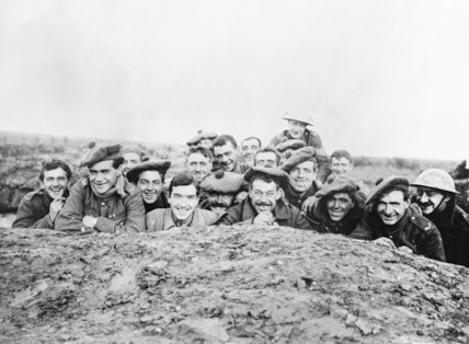 A portrait of a smiling group of Gordon Highlanders in a reserve trench, Bazentin-le-Petit, November 1916.