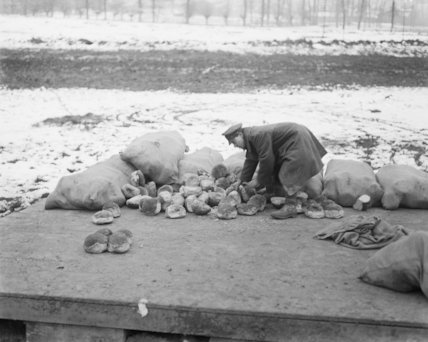 Portioning out the bread at a roadside dump. Albert, March 1917.