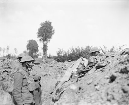 Men of the 12th Battalion, Royal Scots wearing respirators during a gas attack on a front line trench, Meteren, 25 June 1918.
