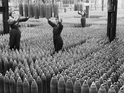 Female munitions workers guide 6 inch howitzer shells being lowered to the floor at the Chilwell ammunition factory in Nottinghamshire in July 1917.