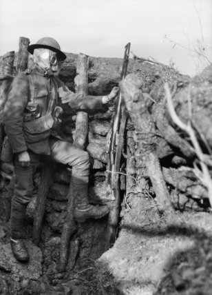 Man of the 3rd Battalion Royal Fusiliers, 85th Brigade wearing a P. H. gas helmet in a trench near Bairakli Jum'a, May, 1917.