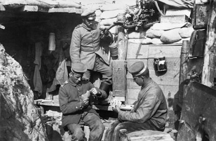 German troops in the trenches playing cards, near Ypres.