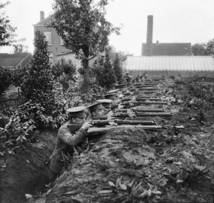 2nd Scots Guards testing a hastily dug trench at Ghent, October 1914.