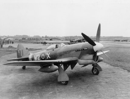 Tempest Mark V, EJ705 W2-X of No. 80 Squadron, on a dispersal at an airfield in Holland, late 1944
