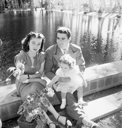 TEHRAN, IRAN:  THE SHAH MOHAMMED REZA PAHLAVI OF IRAN WITH HIS FIRST WIFE, QUEEN FAWZIEH, AND THEIR DAUGHTER, PRINCESS CHAHNAZ SEATED BY AN ORNAMENTAL POOL