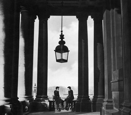 Wren officers framed by Sir Christopher Wren's Colonnade at the Royal Naval College, Greenwich, London, 1941