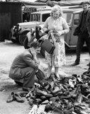 Second-hand shoes for sale at a market in the East End: c. 1948