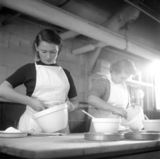 Student nursery nurses learning skills in baking; 1955