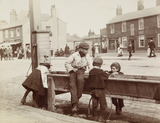 Children Children playing at a water trough in Barnet High Street, c.1900