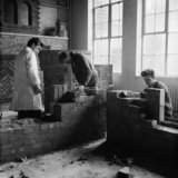 Students undertake brick laying at Hammersmith College of Art; 1963