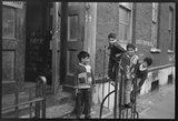 Children at the door of the Brick Lane Jamme Masjid Mosque: 1976