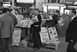 Newspaper seller in the West End; 1960