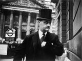 Gentleman in top hat and overcoat at Bank: 1961