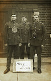 Three soldiers stand with a message of Hope; c.1914