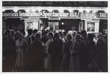 People in the West End at night outside a theatre; 1960
