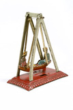 Mechanical penny toy fairground boat swing: 20th century