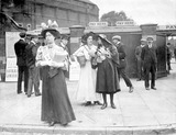 Suffragettes selling Votes for Women at Oval Cricket Ground entrance:1908
