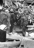 Rescue party pulling a man out of the rubble at number 7 Budge Row: 1944