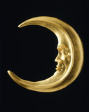 Replica shop sign of a gilded crescent moon; c1976