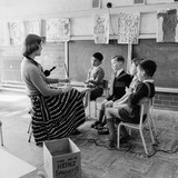 Hearing impaired children in the classroom: 1958