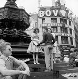 Selling newspapers from the steps of Eros: 1959