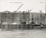 Thames Riverscape showing British and Foreign Wharves, and Millers Wharf: 1937