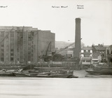 Thames Riverscape showing Pelican Wharf, Pelican Stairs and The Prospect of Whitby Public House: 1937