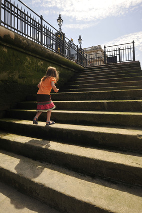 Child running up the steps of the Royal Pier; 2009