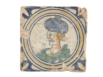 Tin-glazed earthenware medallion tile: Early 17th century