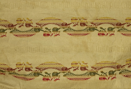 A detail of fabric from a cream silk woven dress; 1753-1780