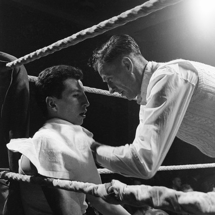 Young boy in a boxing ring: 1958