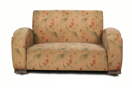 A sofa  decorated with brown flowers; 1938