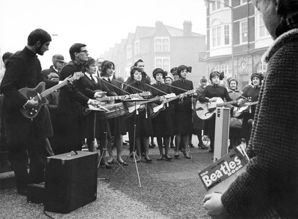 A Salvation Army band playing in the High Street, Tower Hamlets: 1963