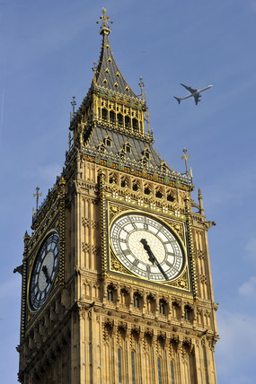 Big Ben with an aeroplane behind it; 2010