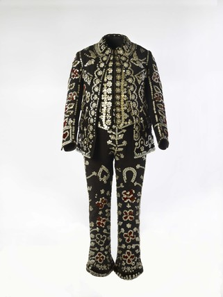 A Pearly King suit decorated with pearl buttons: c. 1940