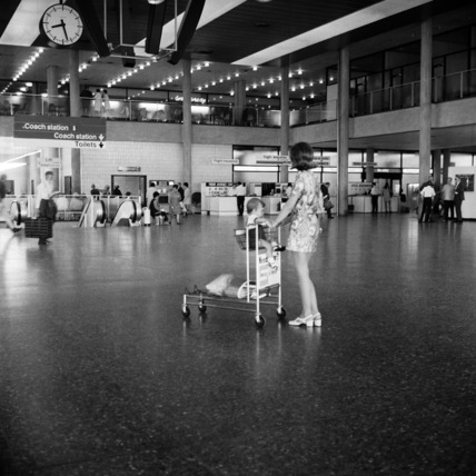 A woman and child at an airport; 1968-1973