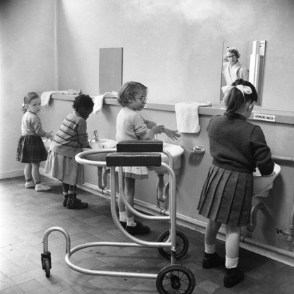 Children in the school toilets at the 'FDR School for Handicapped Children'; 1957