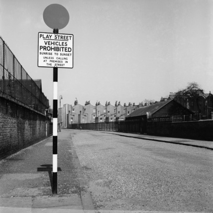 A designated 'play street' clear of traffic; 1956