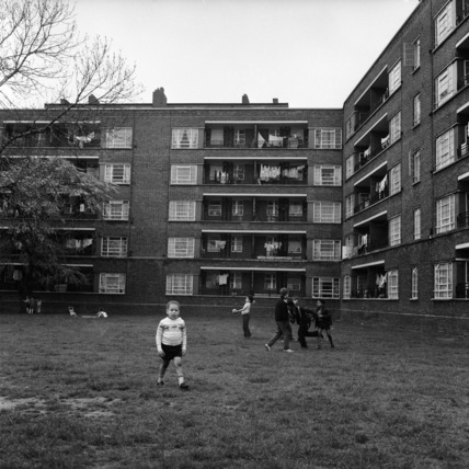Children playing on the grass  in Peckham c 1970