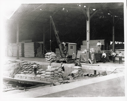 Sugar being unloaded in the Surrey Commercial Dock; c.1920