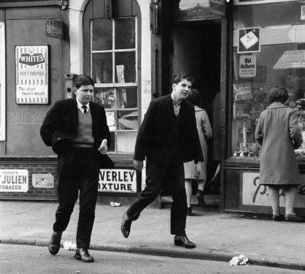 Uniformed school boys walking down the street; c1964